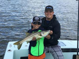 Kid Fishing Snook 21 Tampa Bay Fishing Charter Capt. Matt Santiago